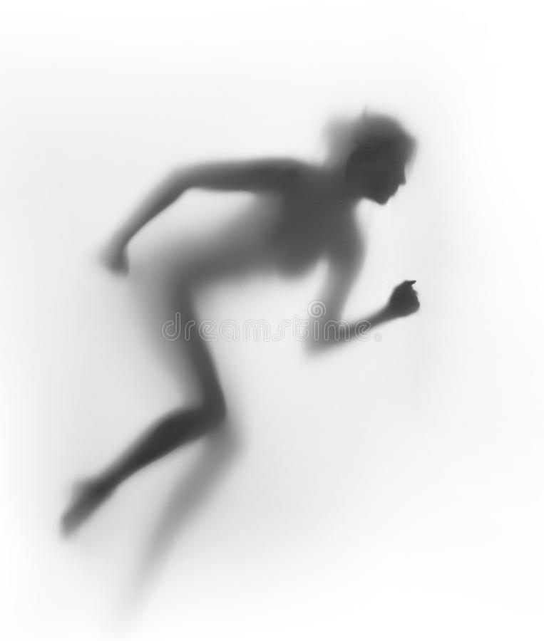 Runner woman body silhouette. Active female human body shape behind a diffuse surface stock photo