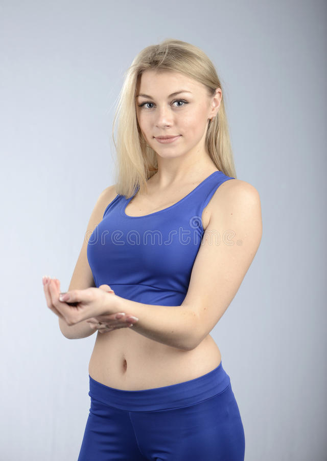 Runner woman checking heart biting rate. Beautiful fit female fitness model is checking heart biting rate stock photos