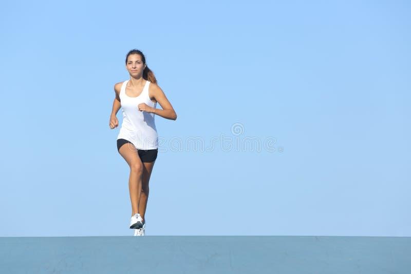 Runner woman running alone stock photo