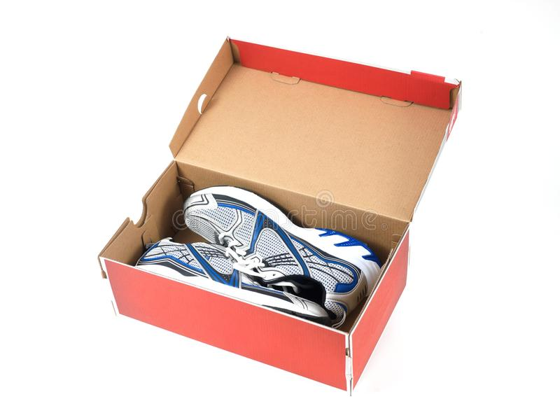 Runners. Sports runners situated in a shoe box stock images