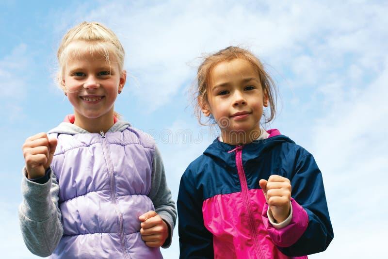 Runners - children running outdoors training stock photo