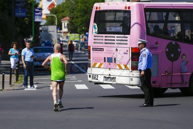 Runners at a city street marathon race stock photography