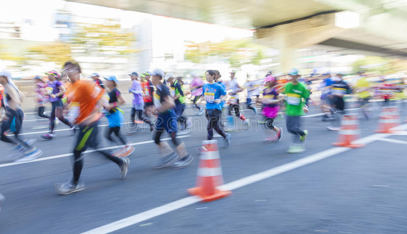 Runners participating in the 2014 Osaka Marathon stock photography