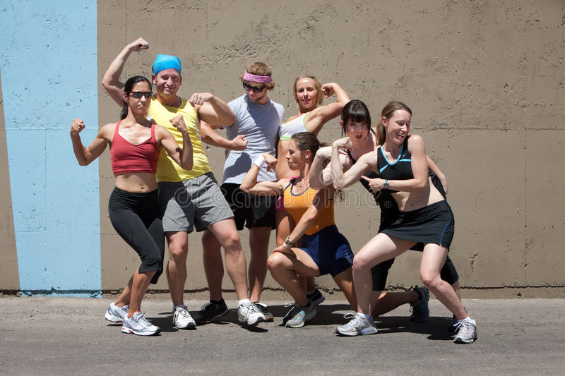 Runners pose for muscle shot stock photos
