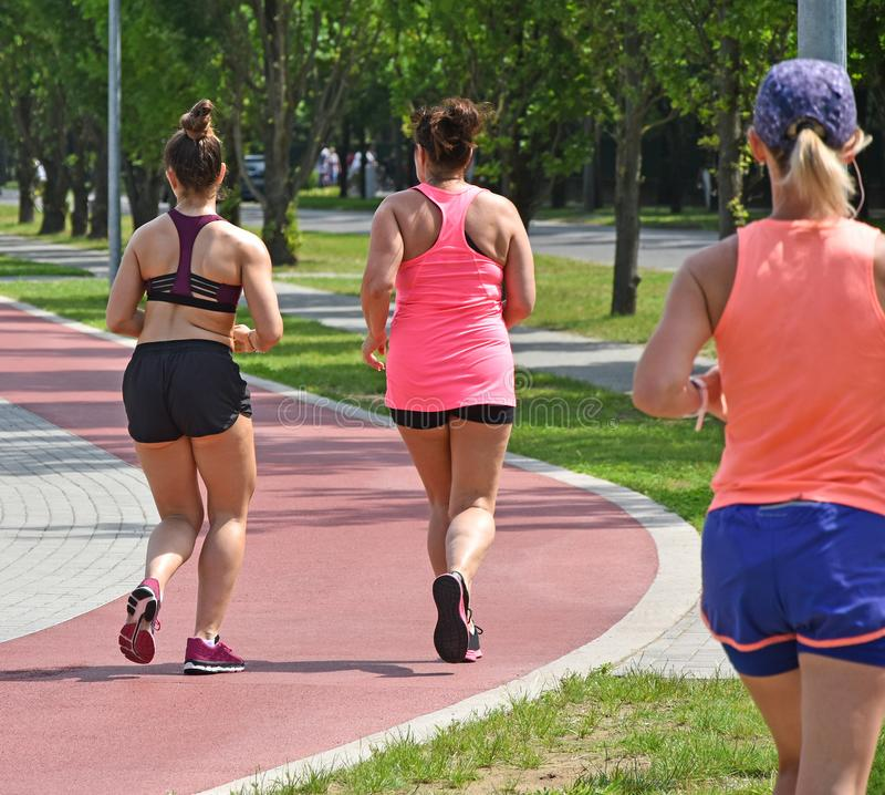 Runners on the running track stock photography