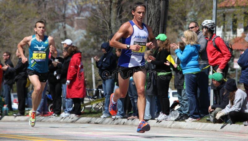 Runners running up Heartbreak Hill