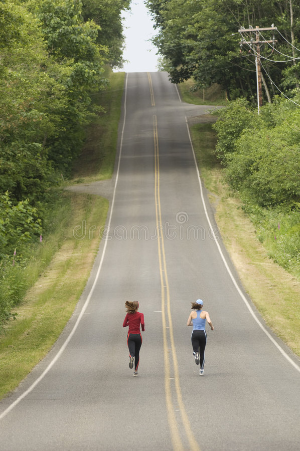 Runners on rural road royalty free stock photography