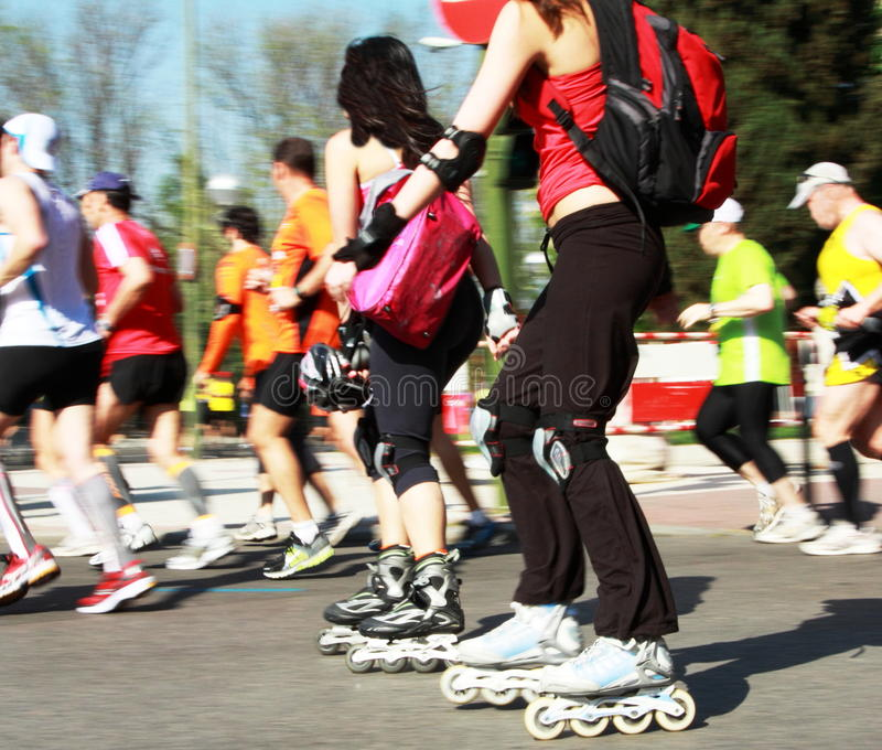 Runners and skaters madrid marathon stock photos