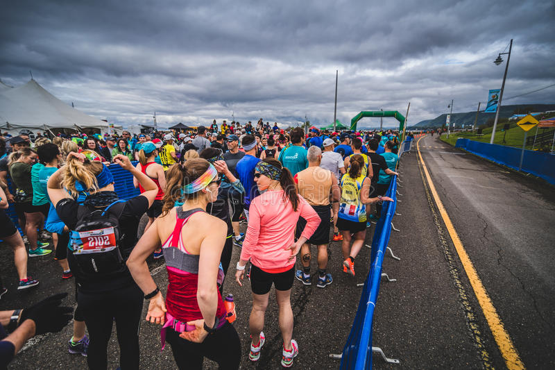 Runners Waiting at the Starting Line. CARLETON, CANADA - June 4, 2017. During the 5th Marathon of Carleton in Quebec, Canada royalty free stock images