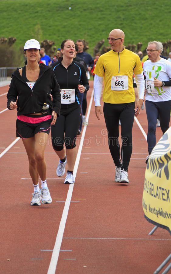 Download Runners Warming Up On The Track Before The Race Editorial Image - Image: 24256830