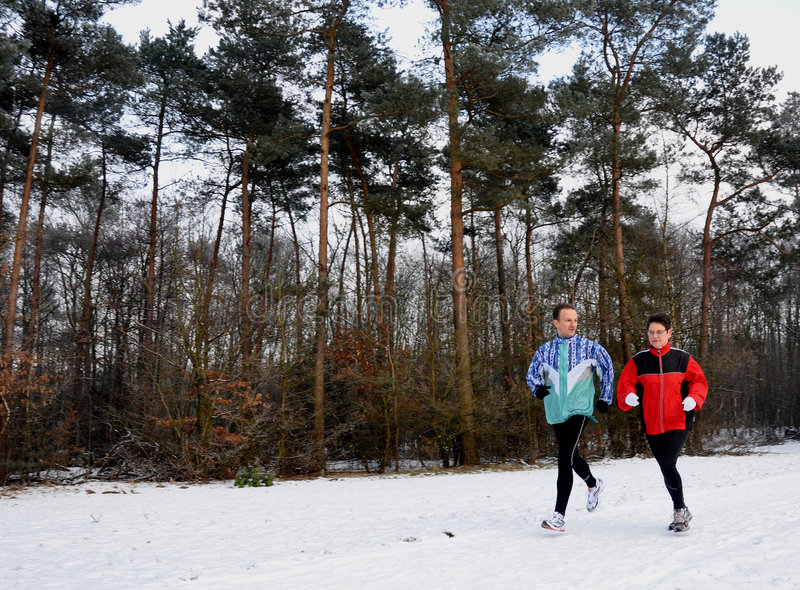 Runners in wintertime stock images