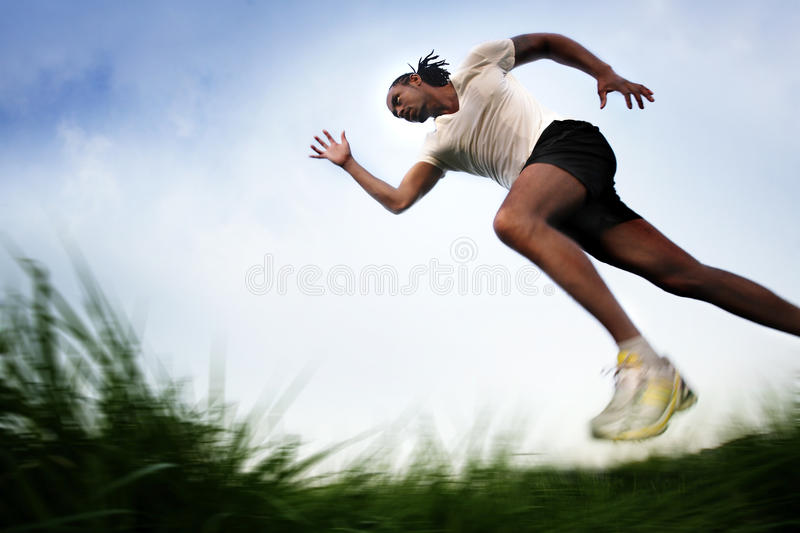 Running across Field stock photography