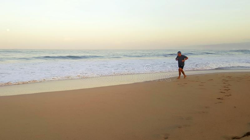 Running along the coast at the morning stock photography