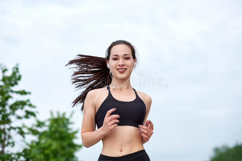 Running asian athlete woman. Morning jogging royalty free stock photography
