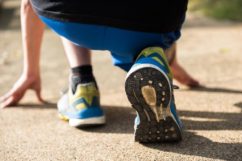 running athlete feet of running shoes stock images