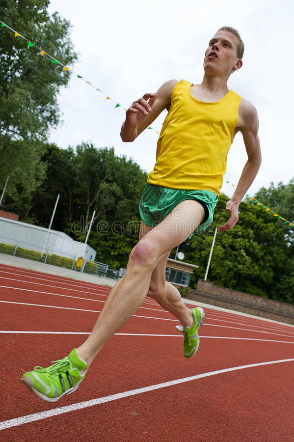 Free Running Athlete In Mid-air Royalty Free Stock Photo - 9693155