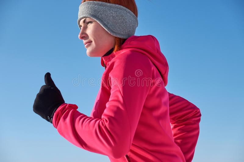 Running athlete woman sprinting during winter training outside i royalty free stock photography