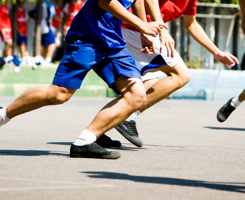 Running for the Ball. Two Players running for the ball stock image