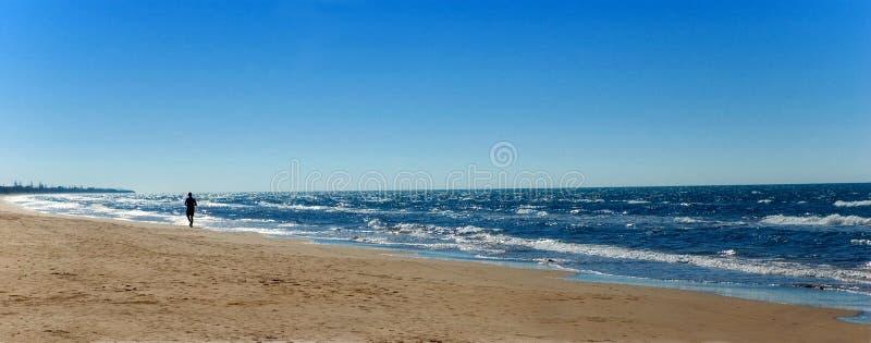 Running on the beach royalty free stock photos