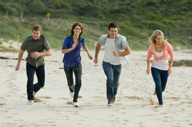 Download Running On The Beach stock image. Image of casual, laughing - 6054013