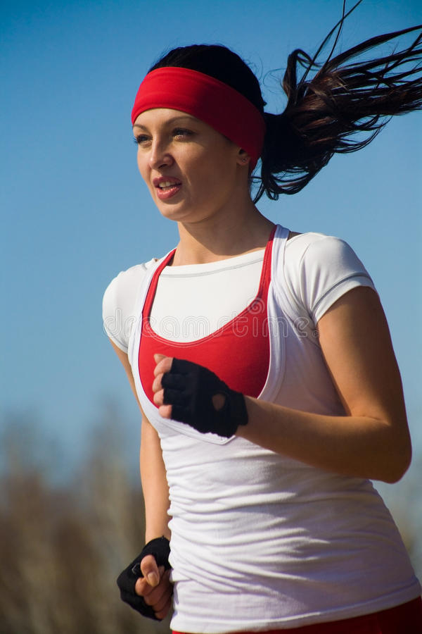 Running beautiful woman stock photography
