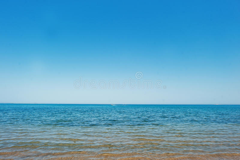 Running boat at blue sea on the horizon royalty free stock image