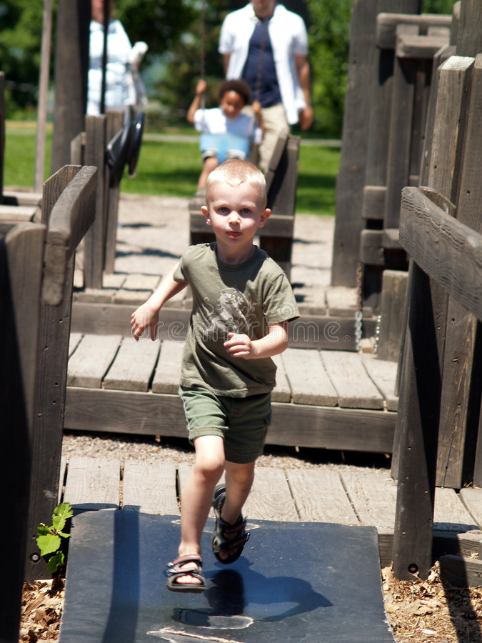 Free Running Boy On Playground 2 Royalty Free Stock Images - 1354449