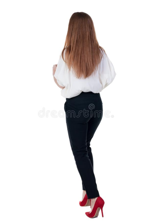 Running business woman. back view. going young girl in suit. Re. Ar view people collection. back side view of person. Isolated over white background. Girl in stock image
