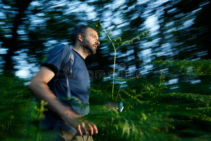 Running for a cache. Hiker running for a cache using global positioning device stock photos