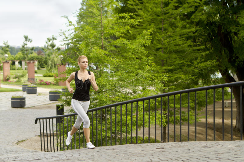 Running in city park royalty free stock images
