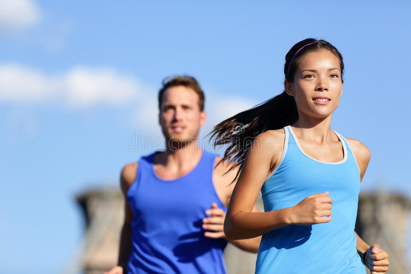Running couple jogging outside in city royalty free stock images