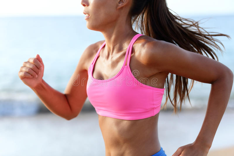 Running Determined Sprinting Woman Runner On Beach royalty free stock photo