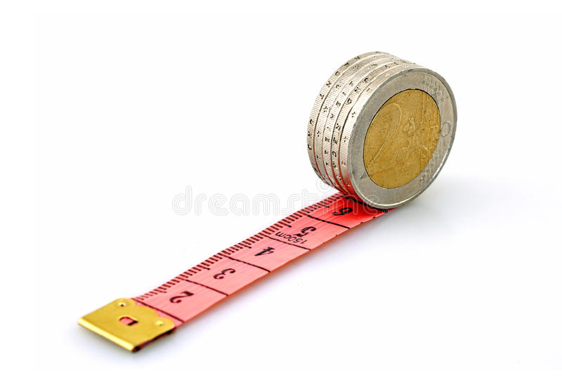 Running euro coins on red ruler stock photos