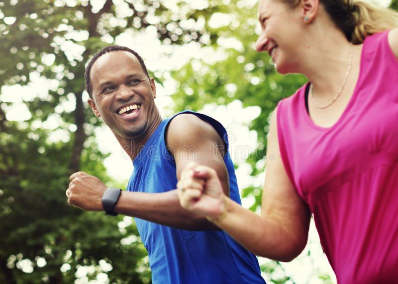Running Exercise Fitness Couple Together Concept stock image