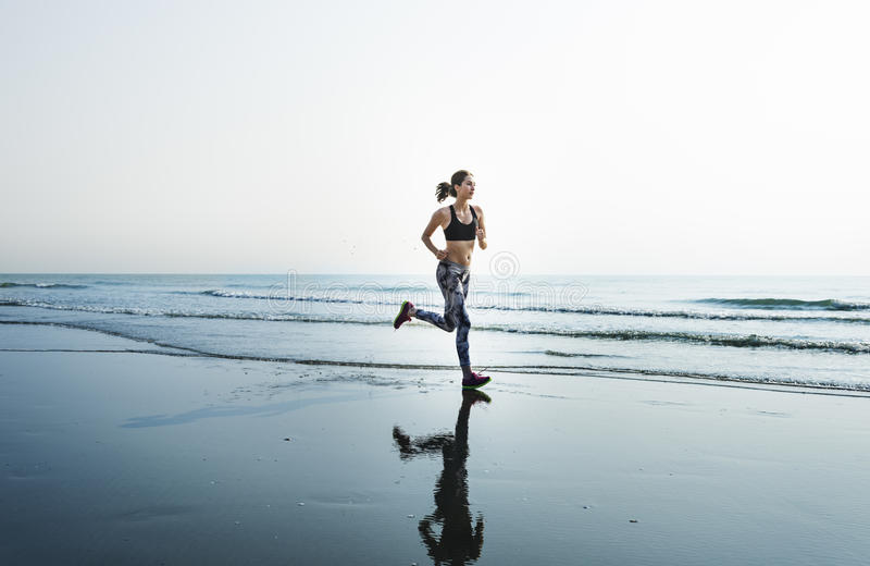 Running Exercise Training Healthy Lifestyle Beach Concept royalty free stock image