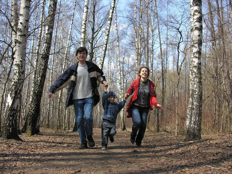 Running family in park royalty free stock photo