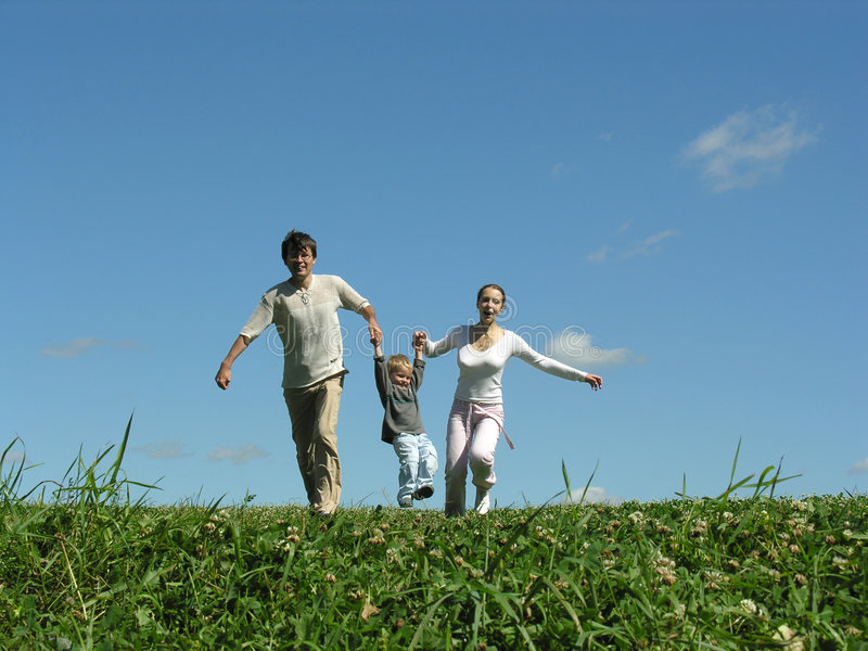 Running family sunny day. Father mother son royalty free stock images
