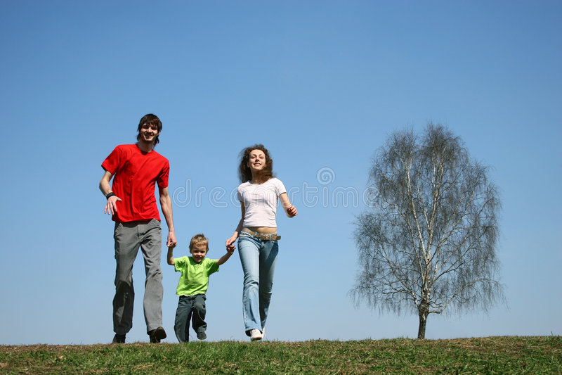 running fjäder för familj royaltyfri bild