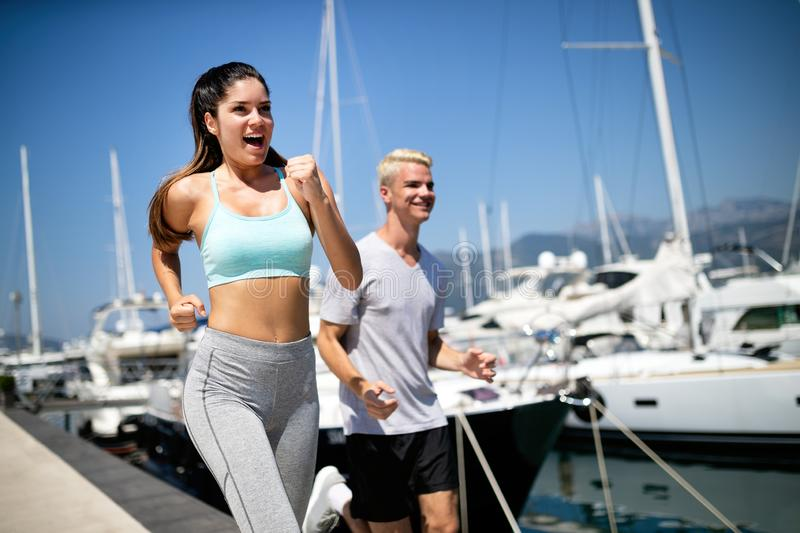 Exercising runners people training outdoors living healthy active lifestyle royalty free stock photography