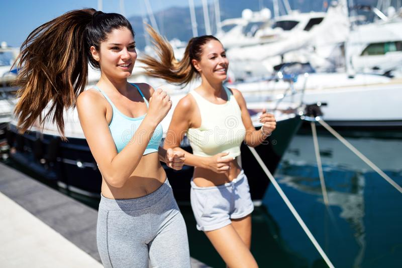 Exercising runners people training outdoors living healthy active lifestyle stock photo