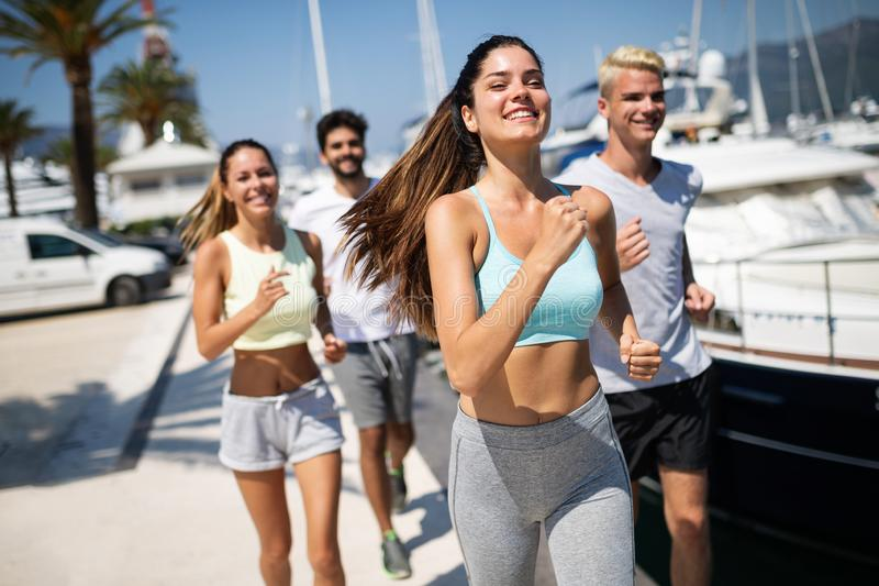 Exercising runners people training outdoors living healthy active lifestyle royalty free stock photos