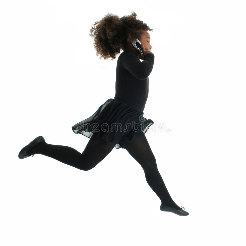 Running Girl with Cellphone. A little African American girl running while talking on a cellphone, isolated on a white background stock photos