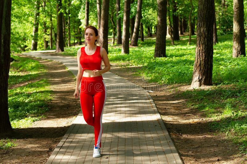 Running girl morning jogging in the woods royalty free stock photos