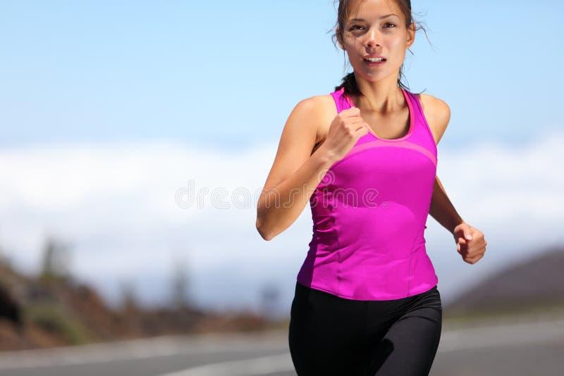 Running girl runner training for marathon royalty free stock image