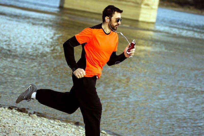 Running jogger at riverside stock photography