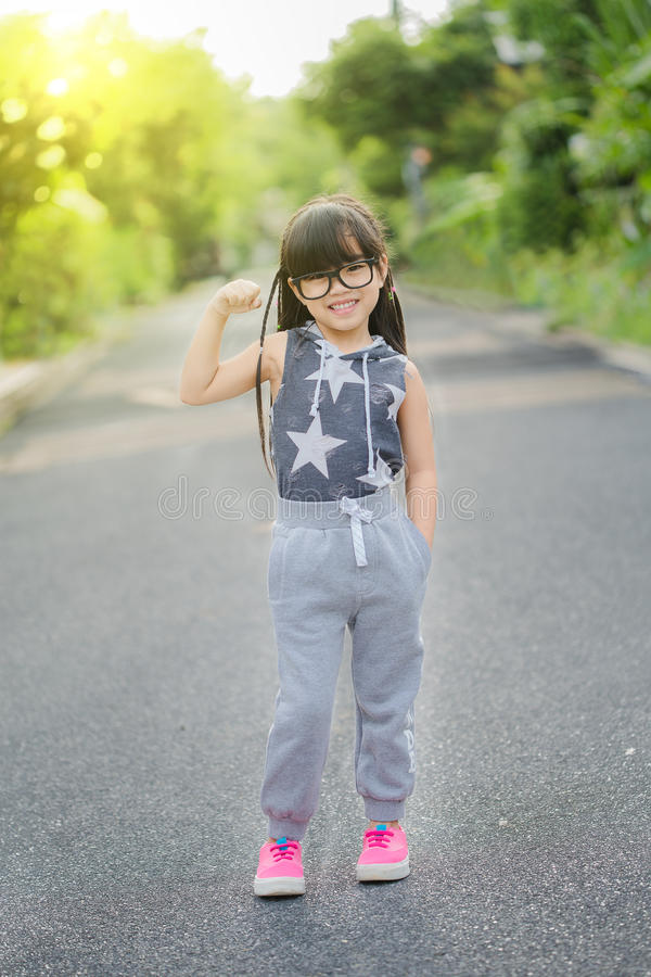 Running kids in park. Asian sport fitness model in sporty running clothes. royalty free stock images