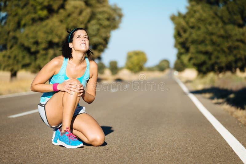 Running knee painful injury royalty free stock photo