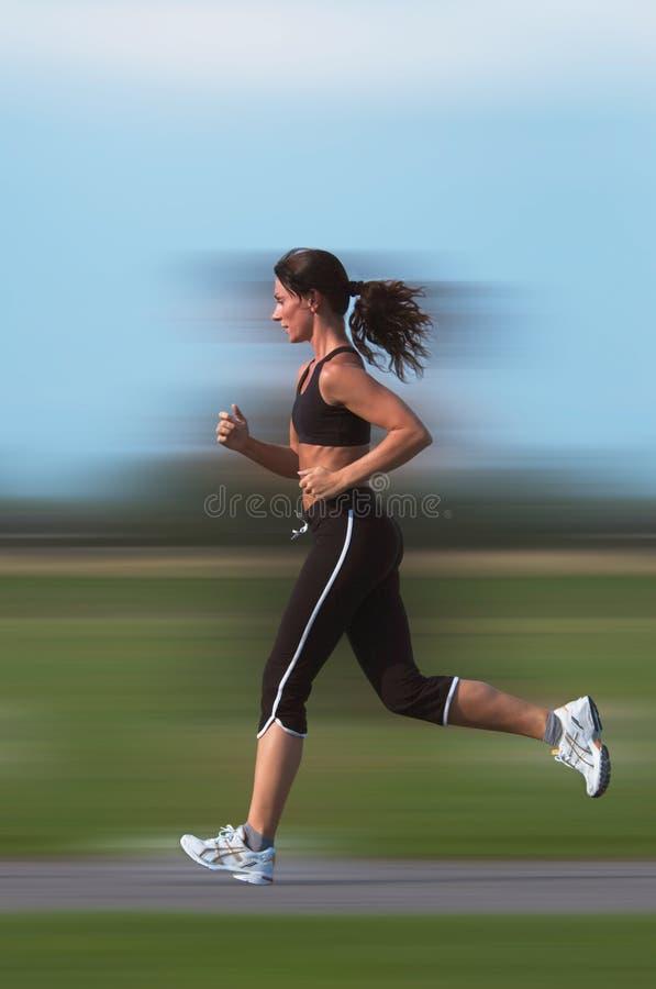 running kvinna arkivbild