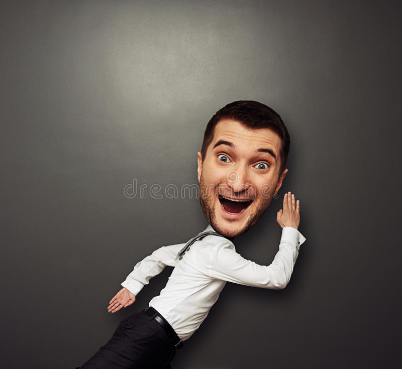 Download Running large-headed man stock photo. Image of male, emotional - 30960768