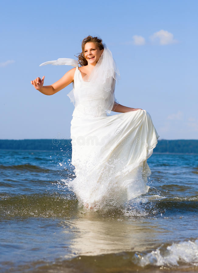 Running Laughing Bride Royalty Free Stock Photography
